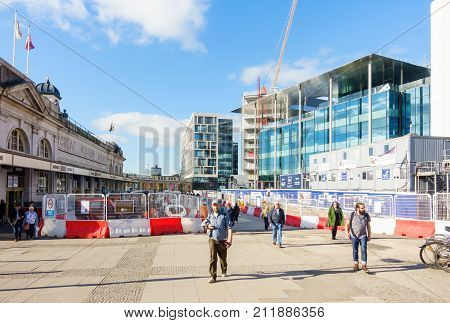 Cardiff United Kingdom Wales - October 27 2017: People are leaving Cardiff Central train station and are passing through the construction site at Central Square previously the central bus station opposite Cardiff Central train station.