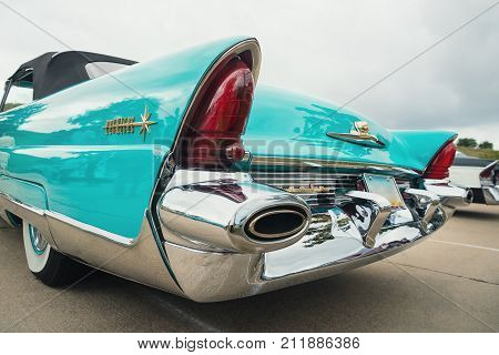 Westlake Texas - October 21 2017: Tail fin and tail light details of a turquoise color 1956 Lincoln Premiere convertible classic car.