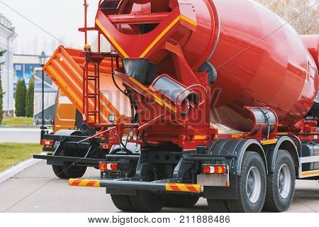Construction truck - concrete mixer with red body, horizontal