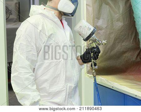 Painter in a car repair station