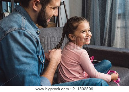 Father Making Hair Braid For Daughter