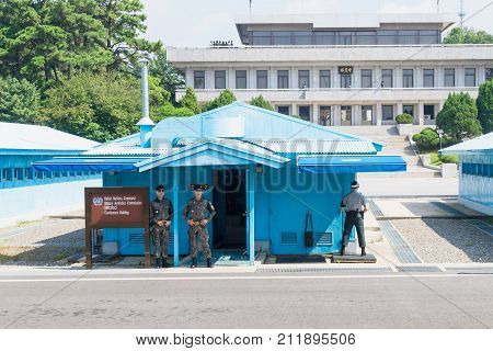 Jsa Within Dmz, Korea - September 8 2017: Un Soldiers And Soldiers In Camoulage Clothes In Front Of