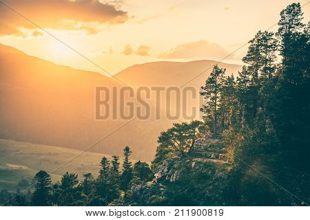 Sunset view from mountaintop, Caucasus, Russia. Vintage toned