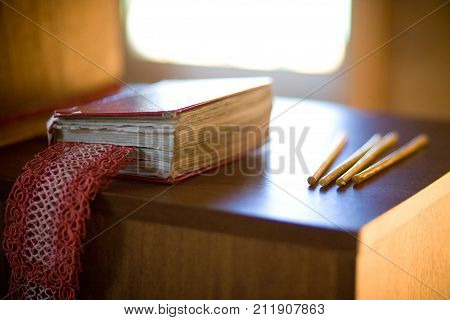 Prayer book and candles on the table