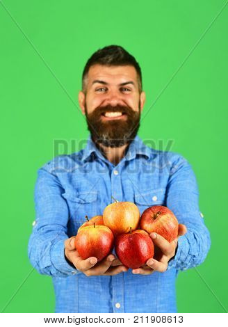 Guy Presents Homegrown Harvest. Farmer With Smiling Face