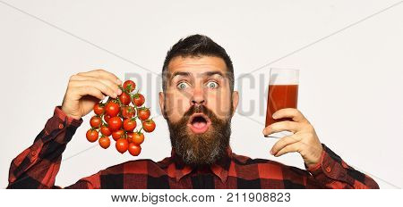 Farmer With Surprised Face Shows Tomato Juice And Cherry Tomatoes
