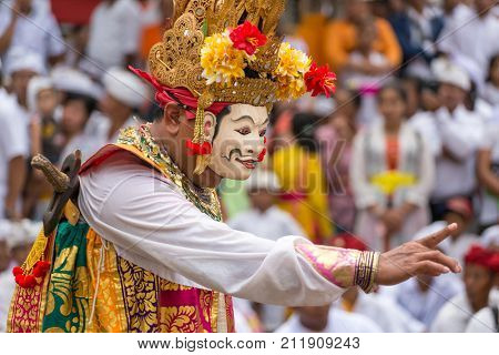 Bali, Indonesia - September 17, 2016: Unidentified balinese people performing in traditional masks during Galungan celebration in Ubud, Bali