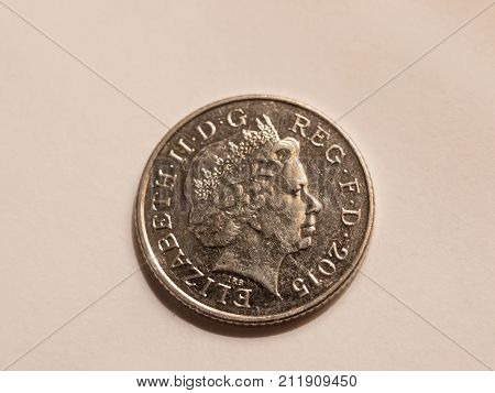 Close Up Of Queen's Head On Coin On White Background Silver 10 Penny