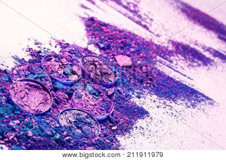 Makeup cosmetics. Eyeshadow crushed palette colorful eye shadow powder on white background