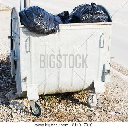 Garbage bin with trash bags.Gray recycle bin trash bin in the park
