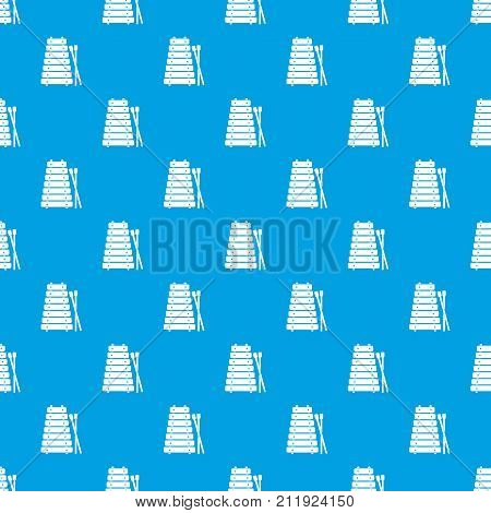 Xylophone and sticks pattern repeat seamless in blue color for any design. Vector geometric illustration