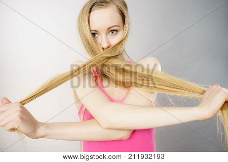 Woman Having Face Covered With Her Blonde Hair