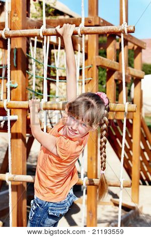 Child climbing on slide. Playground.