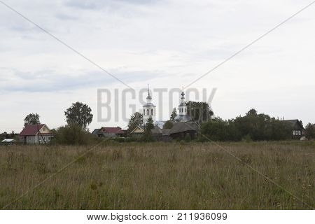 Landscape with Vondokurye village and the Church of the Life-Giving Trinity in Kotlas district, Arkhangelsk region, Russia