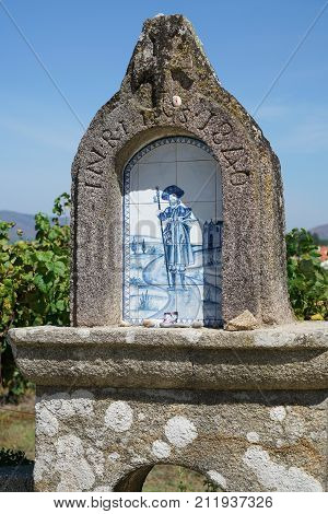 VITORINO DOS PIAES, PORTUGAL - SEPTEMBER 2, 2017: Waymark with relief of Saint James on the Camino de Santiago trail on September 2, 2017 in Portugal, Europe