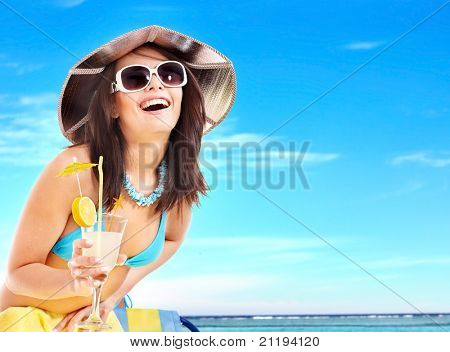 Girl in bikini drink juice through a straw. poster