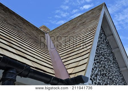 Wooden roof tiles of an old traditional English house. Roofing construction background and texture