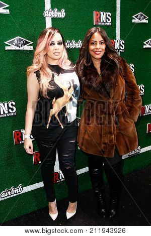 NEW YORK-FEB 1: Singer Lore'l (L) and guest attend the Roc Nation Sports Celebration at the 40/40 Club on February 1, 2014 in New York City.