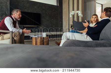 Psychologist Listening To Couple During Session