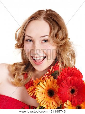 Happy young woman holding red flowers.