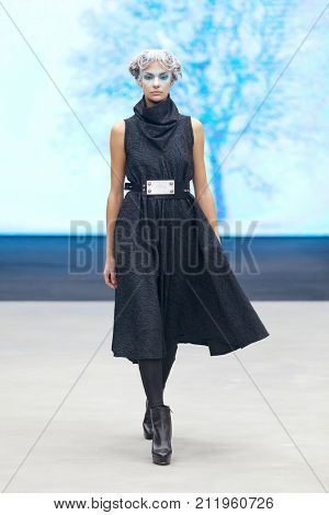 ZAGREB, CROATIA - OCTOBER 28, 2017: Fashion model wearing clothes designed by Marina Design and a belt designed by Marija Ivankovic at the 'Fashion.hr' fashion show