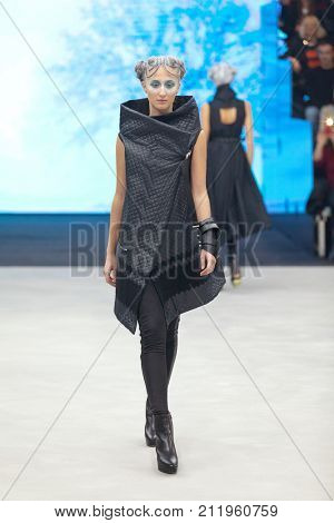 ZAGREB, CROATIA - OCTOBER 28, 2017: Fashion model wearing clothes from the Fall/Winter collection designed by Marina Design and a bracelet designed by Marija Ivankovic at the 'Fashion.hr' fashion show