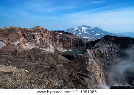 At the top of the volcano are visible: crater lake, gases sulfur fumaroles, and the nearby volcano