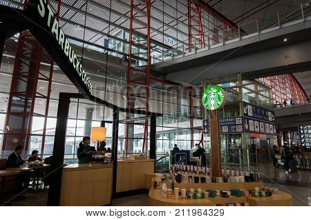 Beijing, China - October 2017: Starbucks Coffee shop in Beijing airport, China. Starbucks Coffee is an American coffeehouse chain operating worldwide including over 2000 shops in the mainland China.