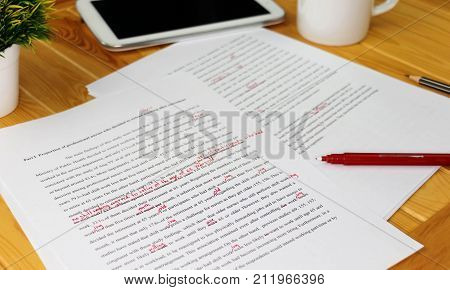hand working on paper for proofreading service