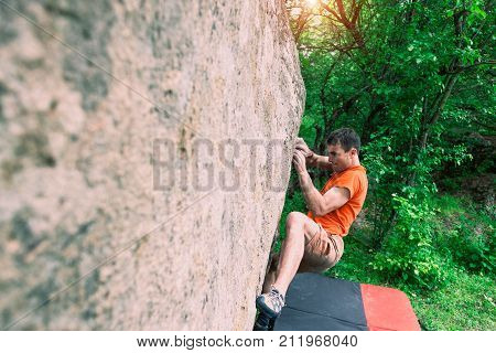 The Climber Is Climbing Bouldering.