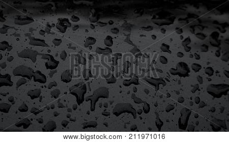 Raindrops on the black background./Water raindrops on the black background.