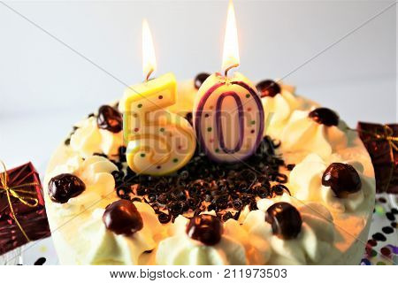An image of a birthday cake with candle - 50