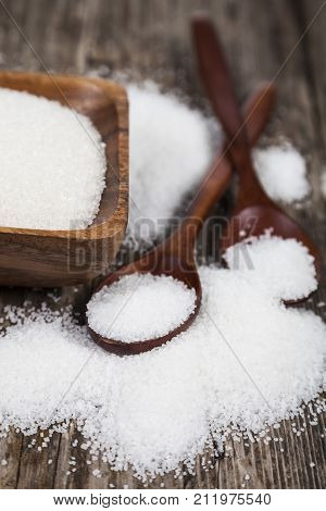 Sugar In A Wooden Bowl And  Two Spoons