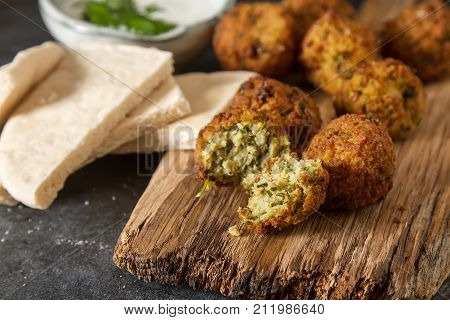 Middle Eastern traditional dishes. Falafel with sour cream. Vegetarian food