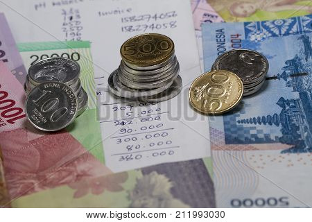 Spending Money and Payment Illustrated with coins, bank notes, and expense calculation in handwriting
