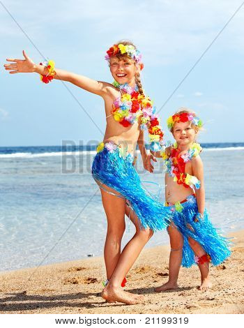 Little girl  playing on  Hawaii beach .