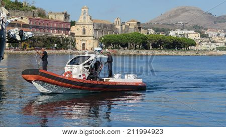 Gaeta Italy - October 11 2017: Coastguard cutter preparing for mooring in bay