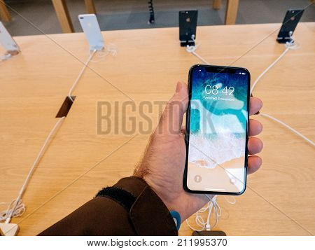 STRASBOURG FRANCE - NOV 3 2017: Latest Apple iPhone X goes on sale in Apple Store worldwide - man holding the iPhone with home screen