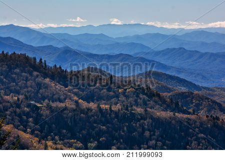 A view from an overlook on the iconic Blue Ridge Parkway in Western North Carolina showing the layers of the distant mountains which it's named for.