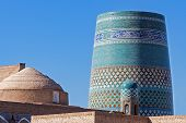 Unfinished turquoise-tiled Kalta Minor Minaret at Ichan Qala - Khiva, Uzbekistan poster