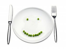 Dinner Plate With Pea In The Shape Of A Smile.