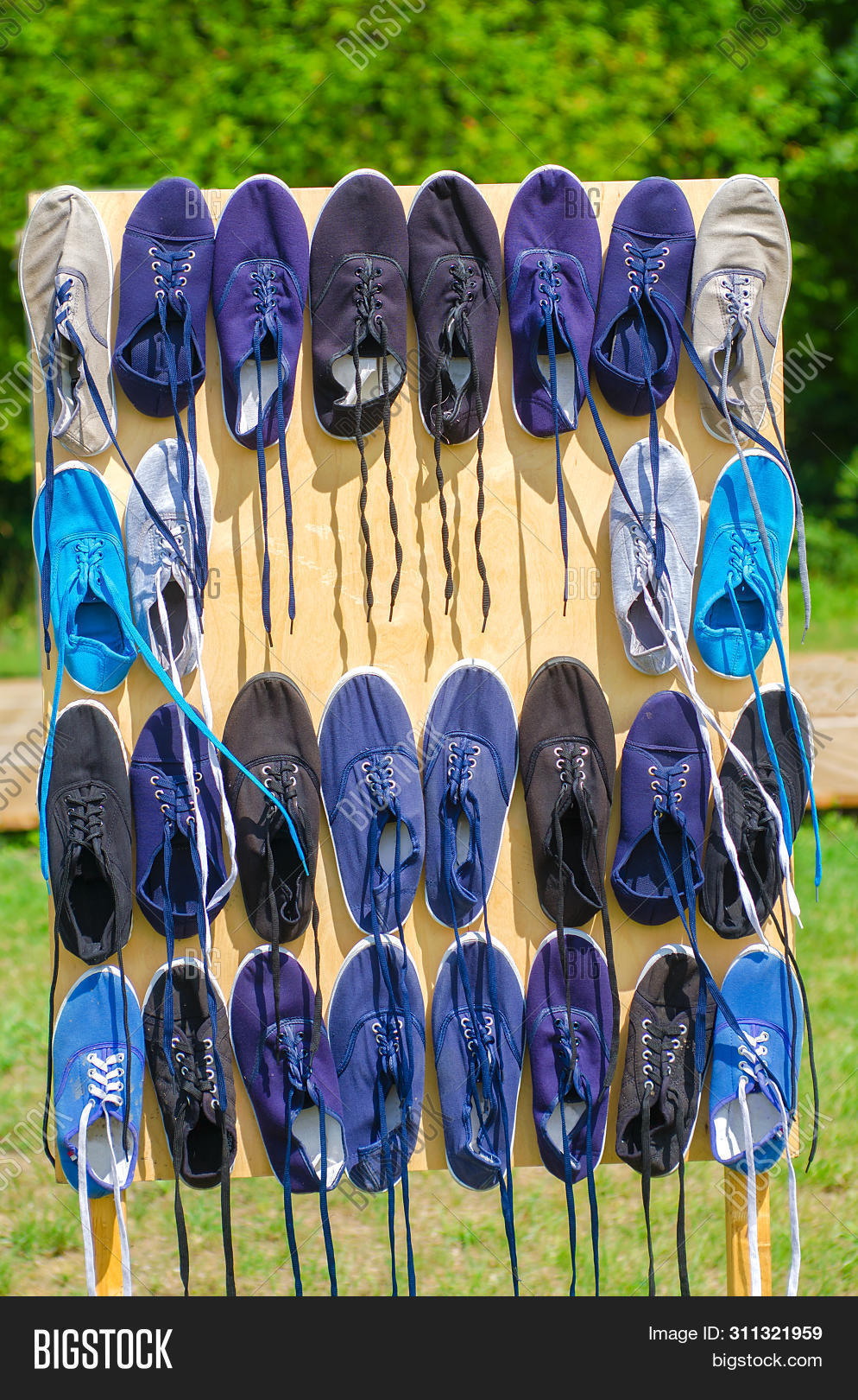 Sport Shoes Hanging On Image \u0026 Photo (Free Trial)