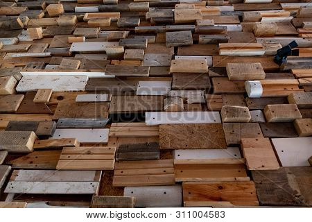 Abstract Shaped Background Made From Reclaimed Wooden Planks And Boards With Rough Scratched And Dam