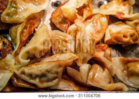 Buffet Tray Of Fried Asian Potsticker Pork Dumplings
