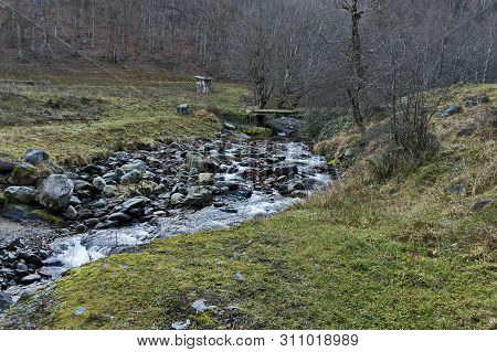 Magnificent landscape with mountain river Vit flowing in the autumn forest over mossy rocks and big stones near Teteven town, Balkan mountains, Bulgaria poster