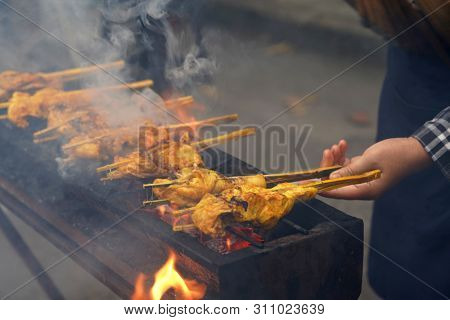 Malaysian traditional dishes, popular grilled spiced chicken Ayam Percik selling in Bazaar during the holy month of Ramadan.