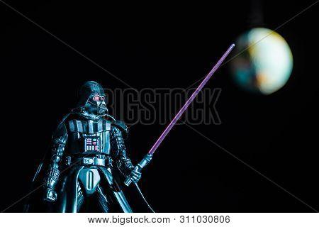 Kyiv, Ukraine - May 25, 2019: Selective Focus Of Darth Vader Figurine With Lightsaber On Black Backg