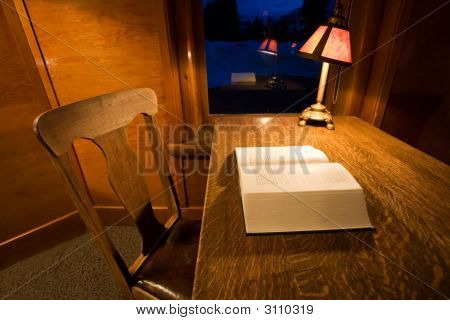 Desk With Book and Lamp
