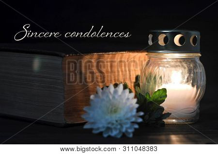 Condolence Card With Memorial Candle, White Flower And Book. Sincere Condolences