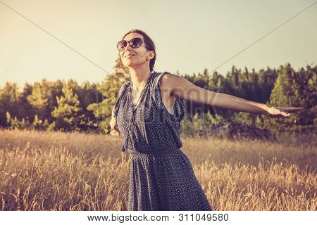Running in sunset. Lifestyle concept. Hipster woman running in sunset in meadow. Healthy lifestyle. People lifestyle. Hipster people lifestyle. Running. People. LIfestyle.